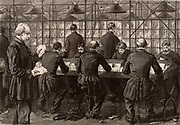French postal service.  Men working in the main letter sorting office, Paris, France.  Engraving from 'Le Journal de la Jeunesse' (Paris, 1886).