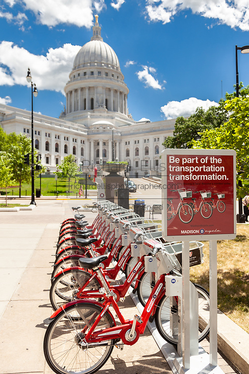 Madison BCycle bike share program parked outside the State House in Madison, Wisconsin.