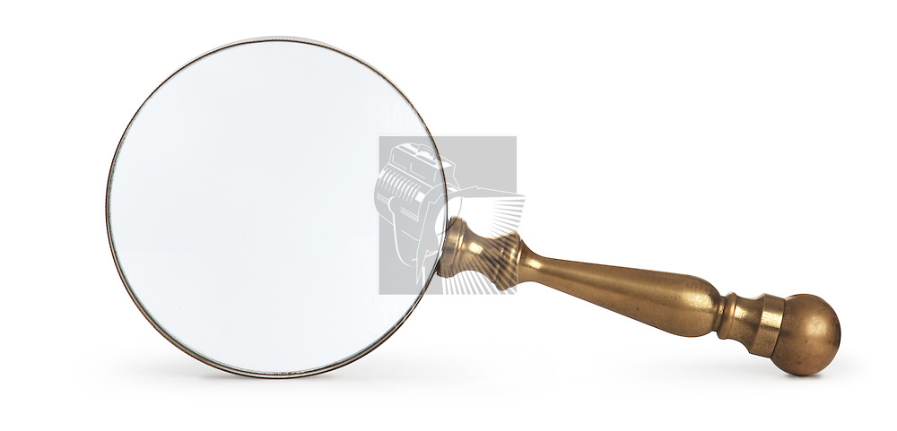 antique brass magnifying glass on white background