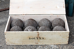 A handsome set of boules awaits a buyer.  Vintage clothing, toys, and antiques share sidewalk space with amazing food and working artists during the Sunday flea markets for which the town of L'Isle-sur-la-Sorgue is famous.