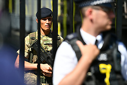 © Licensed to London News Pictures. 25/05/2017. London, UK.   A minutes silence is held on downing street in Westminster, London to honour those who lost their lives in the terrorist attack at Manchester Arena in Manchester, England on May 22nd. 23 people were killed an dozens more injured when Salman Abedi set off a suicide bomb at an Ariana Grande concert. Photo credit: Ben Cawthra/LNP