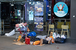 © Licensed to London News Pictures . 25/12/2018 . Manchester , UK . Homeless people sleeping rough outside a branch of Costa Coffee on Market Street in Manchester City Centre on Christmas Day . Photo credit : Joel Goodman/LNP