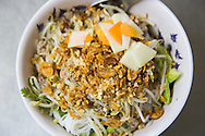 "Traditional vietnamese dish ""bun bo nam bo"", a vermicelli based dish with fried beef, fried onions, beansprouts and herbs . Hanoi, Vietnam, Southeast Asia"