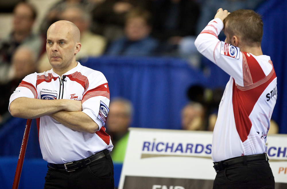 Canadian third Jon Mead, left, and skip Jeff Stoughton contemplate strategy during Canada's 1-2 playoff match against Scotland at the Ford World Men's Curling Championships in Regina, Saskatchewan, April 8, 2011.<br /> AFP PHOTO/Geoff Robins