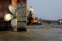 BANGLADESH MADHOM BIBIR HAT 7MARB05 - Shipbreaking yards at Badhom Bibir Hat outside Chittagong, Bangladesh, photographed from the seaside. The propeller is the single most valuable piece of salvageable metal, fetching in the region of USD 30-50.000 apiece...jre/Photo by Jiri Rezac..© Jiri Rezac 2005..Contact: +44 (0) 7050 110 417.Mobile: +44 (0) 7801 337 683.Office: +44 (0) 20 8968 9635..Email: jiri@jirirezac.com.Web: www.jirirezac.com..© All images Jiri Rezac 2005 - All rights reserved.