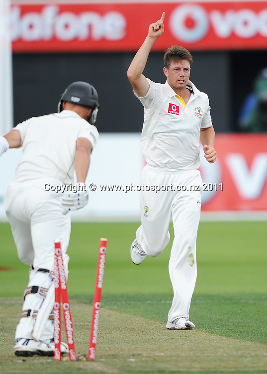 Chris Martin is bowled by James Pattinson on Day 1 of the second cricket test between Australia and New Zealand Black Caps at Bellerive Oval in Hobart, Friday 9 December 2011. Photo: Andrew Cornaga/Photosport.co.nz