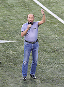 Singer Lee Greenwood, who is famous for singing the song Proud to be an American entertains the crowd with a song after the announcement canceling the game at the Green Bay Packers 2016 NFL Pro Football Hall of Fame preseason football game against the Indianapolis Colts on Sunday, Aug. 7, 2016 in Canton, Ohio. The game was canceled for player safety reasons due to the condition of the paint on the turf field. (©Paul Anthony Spinelli)