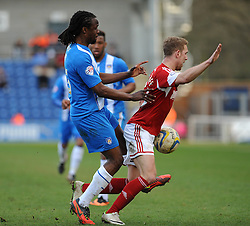 Bristol City's Scott Wagstaff is fouled by Colchester United's Marcus Bean - Photo mandatory by-line: Dougie Allward/JMP - Mobile: 07966 386802 22/03/2014 - SPORT - FOOTBALL - Colchester - Colchester Community Stadium - Colchester United v Bristol City - Sky Bet League One