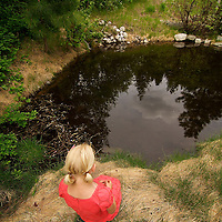 Eva by the clouds in the pond