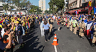 Ecuador fans on the left are separated from French fans on the right by police outside the stadium before the 2014 FIFA World Cup Group E match at Maracana Stadium, Rio de Janeiro<br /> Picture by Andrew Tobin/Focus Images Ltd +44 7710 761829<br /> 25/06/2014