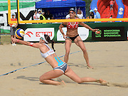 STARE JABLONKI POLAND - July 2:  Joana Heidrich /2/ of Switzerland in action during Day 2 of the FIVB Beach Volleyball World Championships on July 2, 2013 in Stare Jablonki Poland.  (Photo by Piotr Hawalej)
