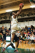 Rice's Ben Shungu (11) leaps for a lay up during the boys basketball game between the Essex Hornets and the Rice Green Knights at Rice Memorial high school on Tuesday night December 22, 2015 in South Burlington.(BRIAN JENKINS/for the FREE PRESS)
