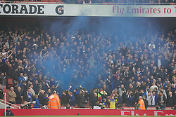 08.03.2014, Emirates Stadium, London, ENG, FA Cup, FC Arsenal vs FC Everton, Viertel Finale, im Bild Everton supporters set off, blue smoke bomb // during the English FA Cup quater final match between Arsenal FC and Everton FC at the Emirates Stadium in London, Great Britain on 2014/03/08. EXPA Pictures © 2014, PhotoCredit: EXPA/ Propagandaphoto/ David Rawcliffe<br /> <br /> *****ATTENTION - OUT of ENG, GBR*****