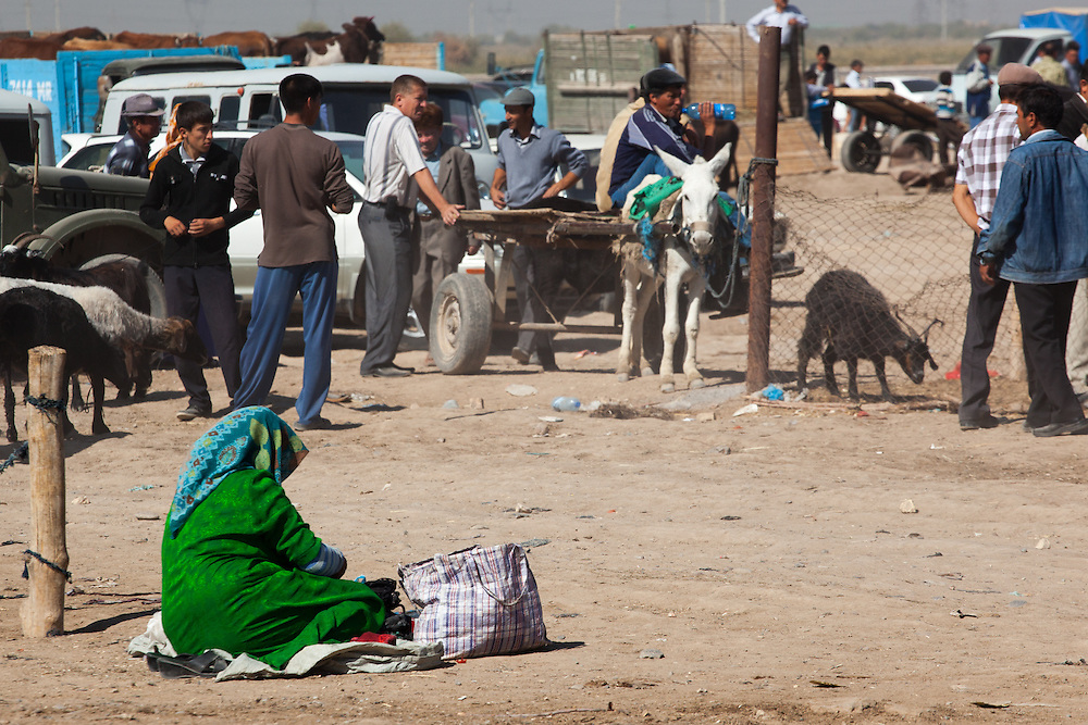 A women selling items at the camel market, Merv, Turkmenistan