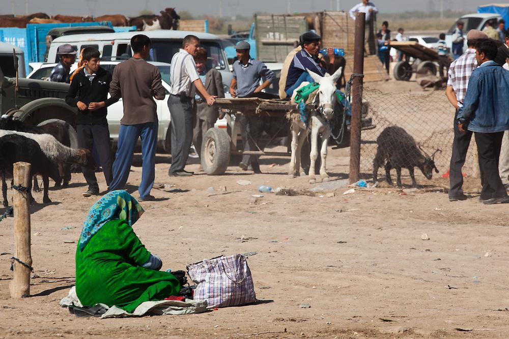 A women selling items at the camel market, Merv, Turkmenistan