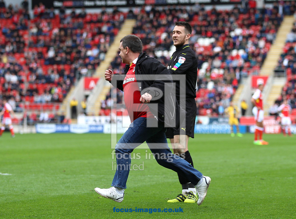 A Rotherham United fan invades the pitch and approaches Lewis Price after Fulham take the lead during the Sky Bet Championship match at the New York Stadium, Rotherham<br /> Picture by James Wilson/Focus Images Ltd 07709 548263<br /> 01/04/2017