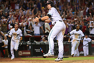 PHOENIX, ARIZONA - APRIL 08:  Chris Owings #16 of the Arizona Diamondbacks safely slides into home plate to score the game winning run in the ninth inning against the Chicago Cubs at Chase Field on April 8, 2016 in Phoenix, Arizona.  (Photo by Jennifer Stewart/Getty Images)