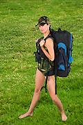 young woman in sexy military uniform with backpack