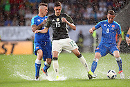 Juraj Kucka (left) and Ondrej Duda of Slovakia tackle Julian Draxler of Germany during the International Friendly match at WWK Arena, Augsburg<br /> Picture by EXPA Pictures/Focus Images Ltd 07814482222<br /> 27/05/2016<br /> ***UK &amp; IRELAND ONLY***<br /> EXPA-EIB-160529-0135.jpg