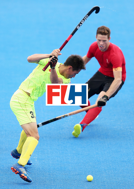 LONDON, ENGLAND - JUNE 24: Jin Guo of China is put under pressure from Tupper Scott of Canada during the 5th-8th place match between Canada and China on day eight of the Hero Hockey World League Semi-Final at Lee Valley Hockey and Tennis Centre on June 24, 2017 in London, England.  (Photo by Alex Morton/Getty Images)
