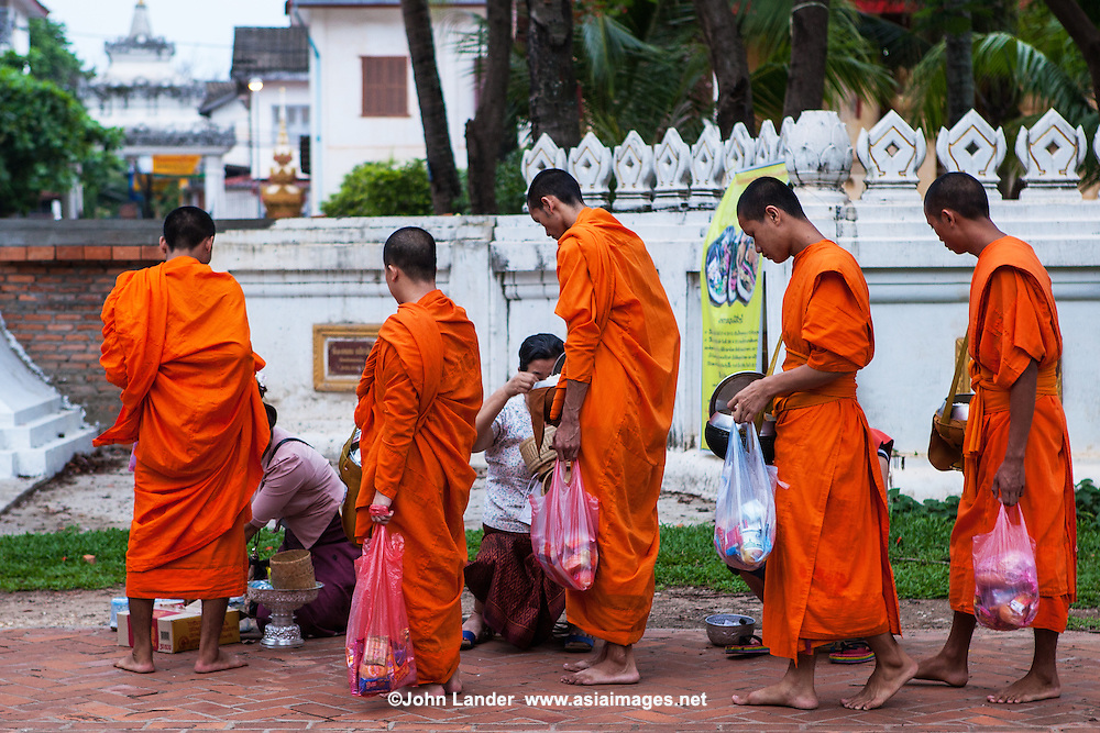 Monks on his Daily Alms Round