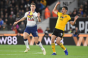 Toby Alderweireld defender of Tottenham Hotspur (4) beats Wolverhampton Wanderers forward Raul Jimenez (9) to the ball during the Premier League match between Wolverhampton Wanderers and Tottenham Hotspur at Molineux, Wolverhampton, England on 3 November 2018.