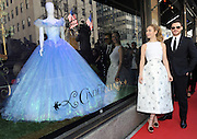 "The stars of Disney's live action film ""Cinderella,"" Lily James and Richard Madden, unveil themed store windows at Saks Fifth Avenue in New York, Monday, March 9, 2015. The windows feature select costumes from the film, as well as a Disney-curated collection of nine luxury designer shoes that re-imagine Cinderella's iconic glass slipper and are for sale exclusively at Saks in the U.S.  ""Cinderella"" opens in theaters nationwide on March 13.  (Photo by Diane Bondareff/ Invision for Disney Consumer Products/AP Images)"