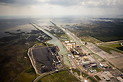 The Crystal River Three Generating Station produces 6.6 megawatt hours per year and uses a one-pass cooling system.  The left channel brings in water from the Gulf and the right channel returns it.  Cooling units on the right channel bank help reduce the water's temperature upon exit.  The excess heat and the energy to run the cooling system represent wasted energy.