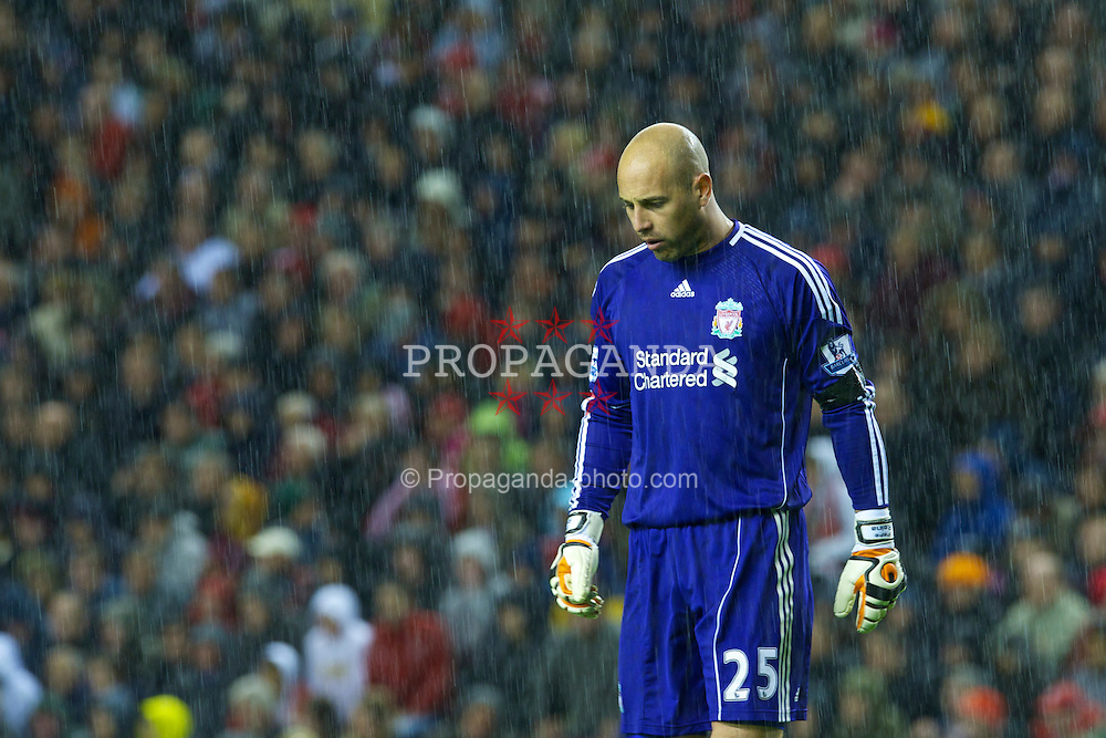 LIVERPOOL, ENGLAND - Monday, April 11, 2011: Liverpool's goalkeeper Jose Reina in the rain during the Premiership match against Manchester City at Anfield. (Photo by David Rawcliffe/Propaganda)