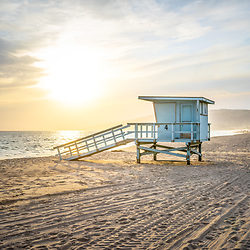 Malibu Zuma Beach lifeguard tower #4 sunset. Malibu is a coastal beach city in Southern California in the United States or America. Copyright ⓒ 2015 Paul Velgos with All Rights Reserved.