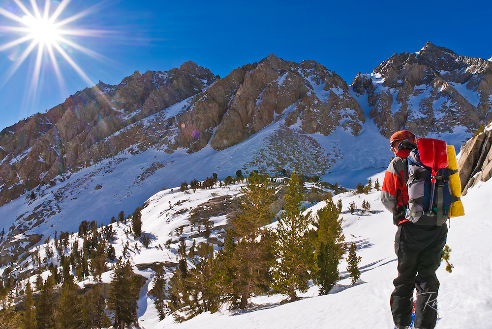 Backcountry skier climbing Piute Pass, Inyo National Forest, Sierra Nevada Mountains, California
