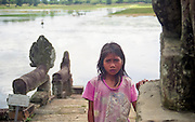 A young Khmer girl at Great Lake near UNESCO World Heritage Site Angkor Wat, Cambodia.