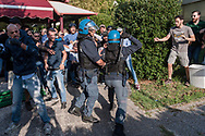 ROME, ITALY - SEPTEMBER 13:  Police attempt to control Casapound's extreme right-wing militants as they clash with the anti-fascists in front of the Fourth Town Hall, where the future of a centre for refugees was discussed on September 13, 2017 in Rome, Italy. Far right movement Casapound are demanding the closure of the centre which is run by the Red Cross in District Tiburtino IV in Rome.  (Photo by Stefano Montesi )