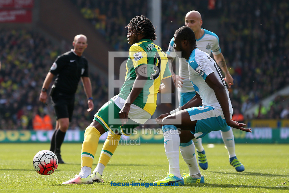 Dieumerci Mbokani of Norwich and Chancel Mbemba of Newcastle United in action during the Barclays Premier League match at Carrow Road, Norwich<br /> Picture by Paul Chesterton/Focus Images Ltd +44 7904 640267<br /> 02/04/2016