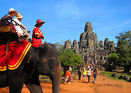 Elephant carries tourists through the ancient Angkor ruins, Siem Reap, Cambodia, Southeast Asia