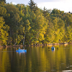 Fishing from a kayak on the Indian Pond section of the Kennebec River near Moosehead Lake.  Owned by Plum Creek.