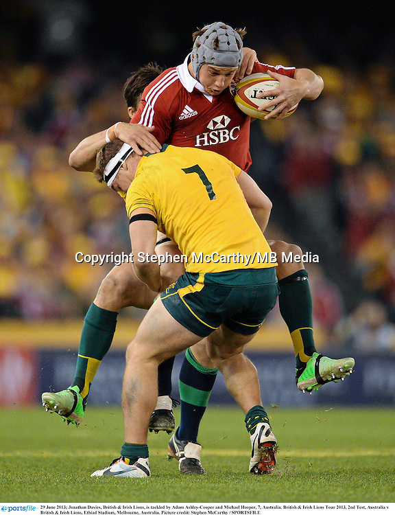 29 June 2013; Jonathan Davies, British & Irish Lions, is tackled by Adam Ashley-Cooper and Michael Hooper, 7, Australia. British & Irish Lions Tour 2013, 2nd Test, Australia v British & Irish Lions, Ethiad Stadium, Docklands, Melbourne, Australia. Picture credit: Stephen McCarthy / SPORTSFILE