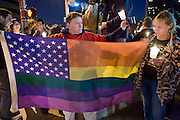 November 10, 2008 -- PHOENIX, AZ: Women hold up a gay rights flag during a gay rights vigil in Phoenix Monday.  About 250 people attended a candle light vigil in support of gay rights and gay marriage in Phoenix, AZ, Monday night. The rally, like similar ones in Los Angeles and Salt Lake City, were in response to anti-gay marriage and anti-gay rights initiatives that were passed by the voters in Arizona, California and Florida. The anti-gay initiatives in Arizona and California were funded by conservative churches, including the Church of Latter Day Saints (Mormons). Photo by Jack Kurtz / ZUMA Press