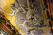 "JAPAN, NIKKO - August 2012 - The Honji-do Temple ""crying dragon"". This dragon is painted on the ceiling of the temple. It makes a sound like roaring when clappers are struck standing underneath the dragon. Toshogu Shrine is where the famous Shogun of the Edo Period in the 17th century, Tokugawa Ieyasu, was worshiped after his death. It became as luxurious and elaborate as it looks today when the grandson of Ieyasu, the third Shogun Tokugawa Iemitsu, reconstructed it. The engravings on the Yomei-mon Gate are especially overwhelming, provided with every luxury imaginable and redolent in gorgeous colors. site calssified as Japanese Cultural property and world heritage by UNESCO [FR] Le plafond du Honji-do s'orne du "" dragon pleureur "" qui renvoie un écho si l'on frappe des mains au-dessous de lui. Sanctuaire Toshogu - Construit en 1636 à la mémoire de Ieyasu, fondateur du shogunat Tokugawa. Contrairement aux autres sanctuaires shinto, caractérisés par une architecture épurée se fondant dans le paysage environnant, ce sanctuaire est une exubérance de couleurs, d'applications de feuilles d'or et de sculptures en tous genres.Site classé propriete culturelle du Japon et patrimoine mondial de l'UNESCO"