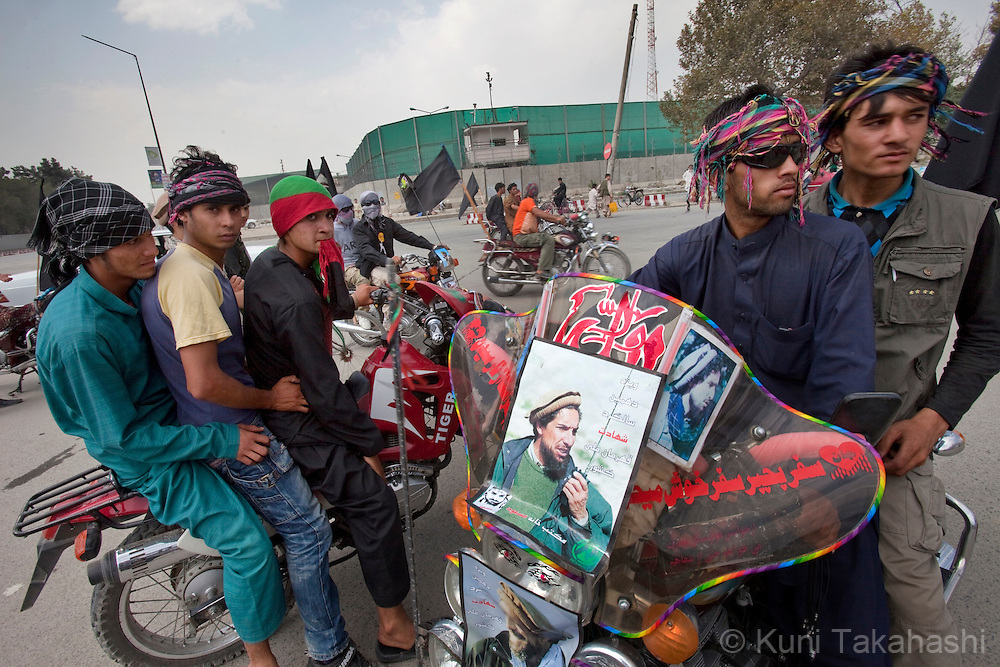 Supporters of late Commander Ahmad Shah Massoud march with his pictures at Massoud Circle in Kabul, Afghanistan on Sep 9, 2011 to pay tribute on the 10th anniversary of his assassination. .Two foreign suicide assassins murdered Massoud, a military leader who played a leading role in driving the Soviet army out of Afghanistan, on Sept. 9, 2001 in Takhar province of Afghanistan..(Photo by Kuni Takahashi) .