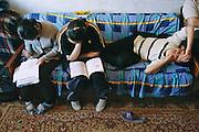 (MODEL RELEASED IMAGE). Khorloo and Batbileg Batsuuri, and their cousin Suvd Erdene do their homework. Ulaanbaatar, Mongolia. Hungry Planet: What the World Eats (p. 229).