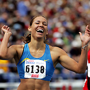 Local girl Lolo Jones rejoices after winning the special 100 meter hurdles at the Drake Relays.  Jones, who now runs for a track club, attended high school in Des Moines. photo by david petersonDes Moines, Ia., April 25, 2009 - DRAKE RELAYS PHOTOGRAPH BY DAVID PETERSON -