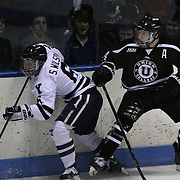 Shayne Gostisbehere, (right), challenges Stu Wilson, Yale,  during the Yale Vs Union College, Men's College Ice Hockey game at Ingalls Rink, New Haven, Connecticut, USA. 28th February 2014. Photo Tim Clayton