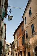 A street of old houses in Montalcino, Tuscany, Italy