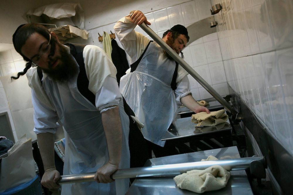 Ultra-Orthodox Hassidic Jews prepare matza, a cracker-like bread, for the upcoming Jewish holiday of Passover in a bakery in the ultra orthdox neighborhood of Mea Shearim in Jerusalem on March 23, 2009. Preparations are closely supervised to ensure the matza is unleavened in accordance with ritual law. Passover commemorates the flight of Jews from ancient Egypt as described in Exodus. According to the account, the Jews did not have time to prepare leavened bread before fleeing to the Promised Land. Photo by Olivier Fitoussi /ABACAUSA
