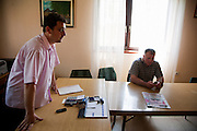 Goran Grahovac, secretary (left), and Radmilo Stanisic, mayor, of Lazarevo, Serbia in their offices...Matt Lutton for The International Herald Tribune..Capture of Ratko Mladic. Lazarevo, Serbia. May 27, 2011.