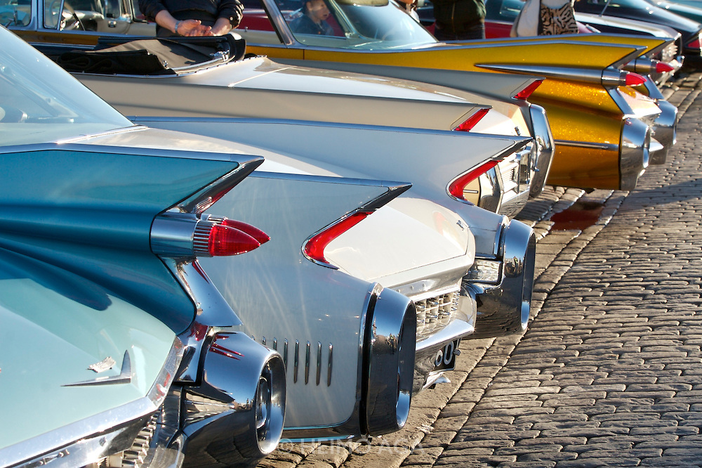 During summer from June to Septemper, every first Friday of the month is Vintage Car Cruising Night. Hundreds of classic American cars cruise around downtown Helsinki and meet at special places to have a good time, here at Kauppatori (Market Square). Cadillac fins.