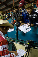 Canadian rodeo clown Crash Cooper signs autographs for young fans during the PBR rodeo at the Del Mar Fairgrounds in Del Mar, California on July 27th, 2008.  It was the second night of the PBR's tour stop in Del Mar.