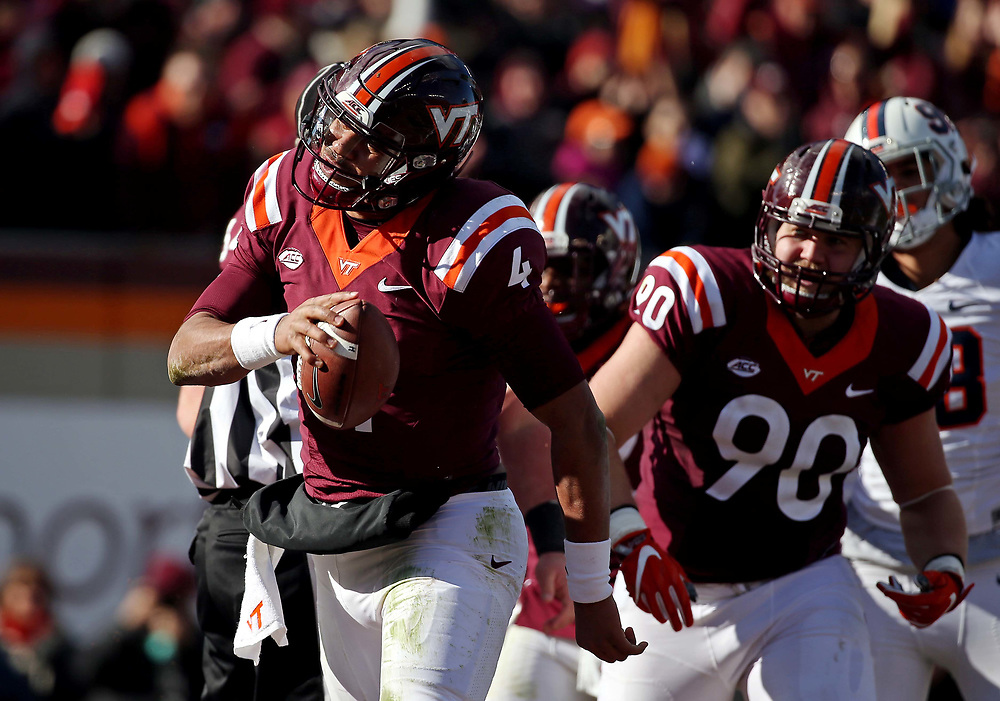 Nov 26, 2016; Blacksburg, VA, USA;  Virginia Tech Hokies quarterback Jerod Evans (4) reacts after a touchdown during the second quarter at Lane Stadium. Mandatory Credit: Peter Casey-USA TODAY Sports