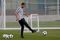 SAINT PETERSBURG, RUSSIA - JUNE 13: England national team head coach Gareth Southgate kicks the ball during an England national team training session ahead of the FIFA World Cup 2018 in Russia at Stadium Spartak Zelenogorsk on June 13, 2018 in Saint Petersburg, Russia.